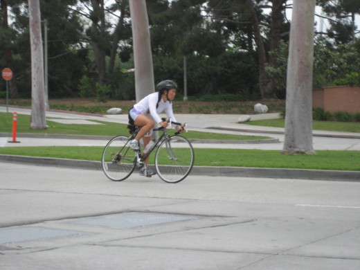 Cathy bicycling at CSULB Reverse Triathlon