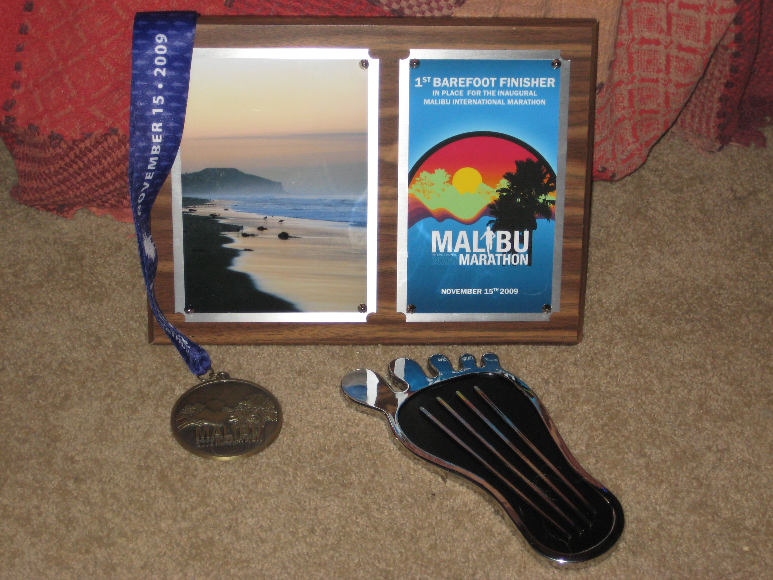 Finish award and first barefoot marathon finisher