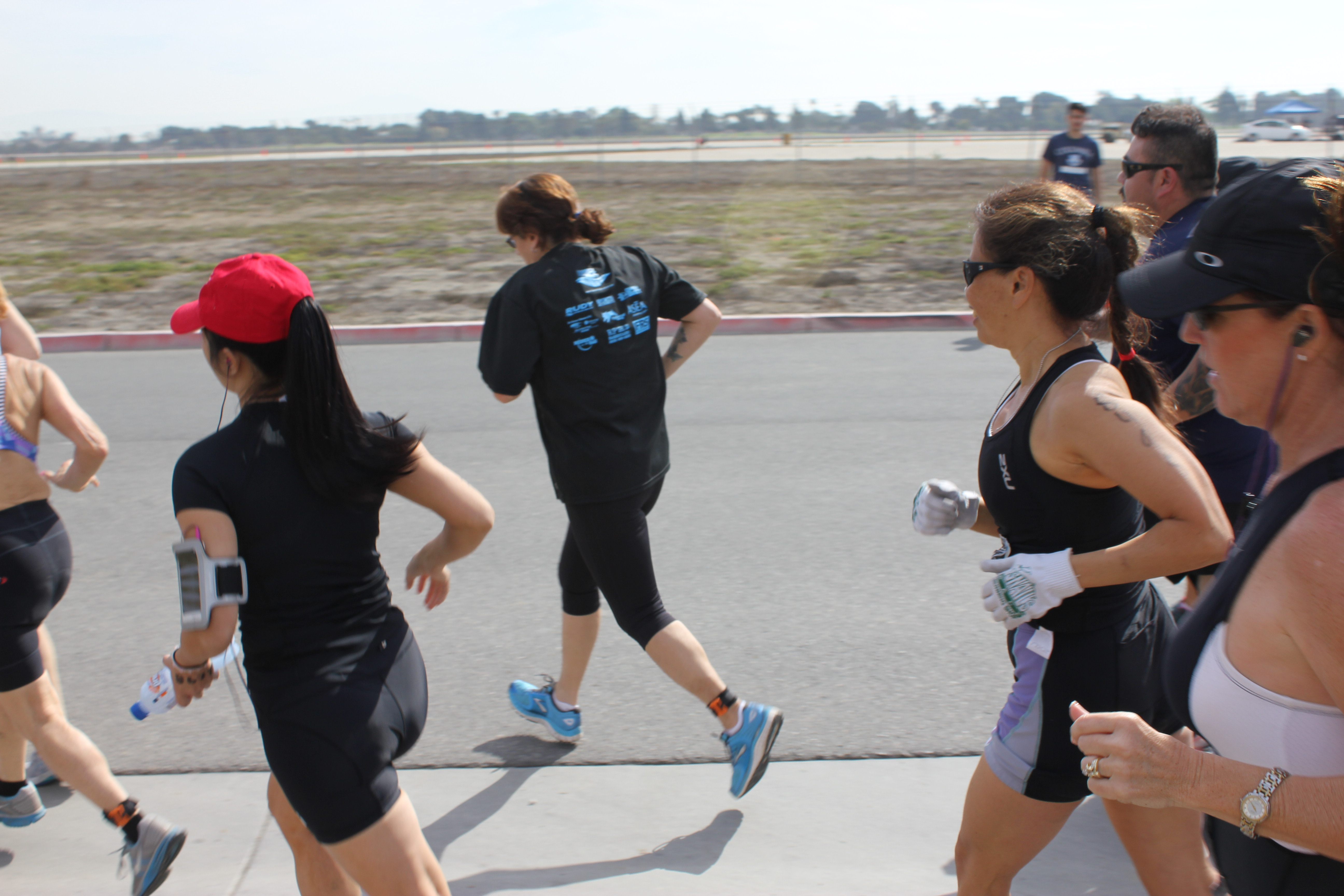 Cathy running (with white gloves)